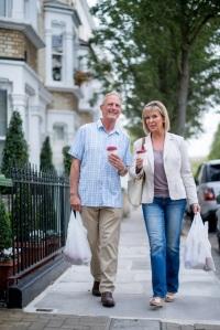 Couple walking at the neighborhood
